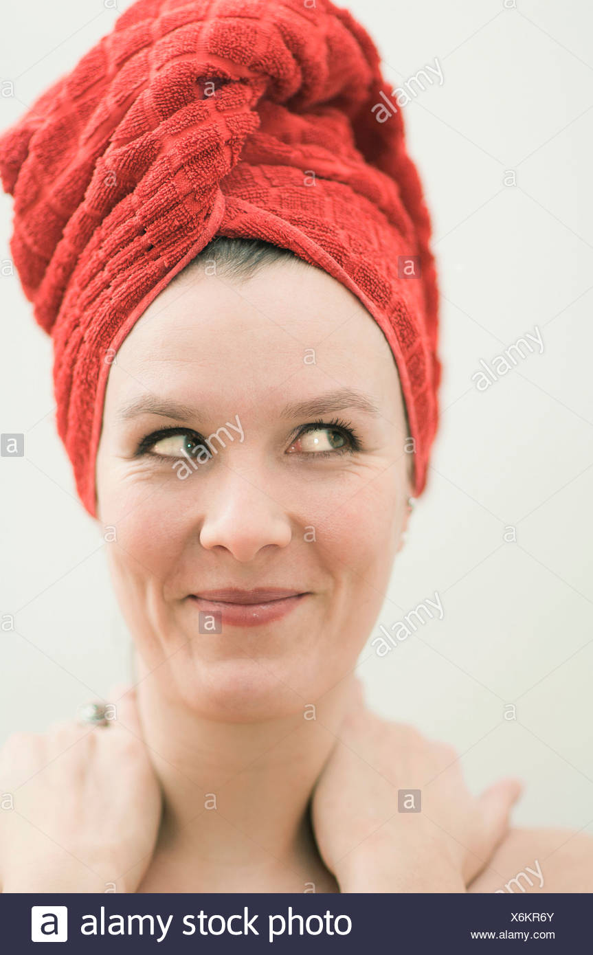 Woman in towel side glance - Stock Image