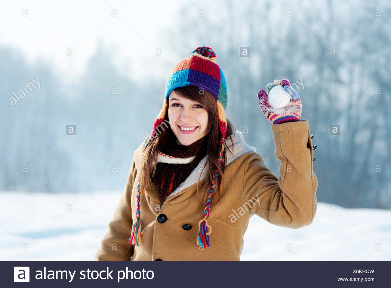Young woman throwing snowball Debica, Poland - Stock Image