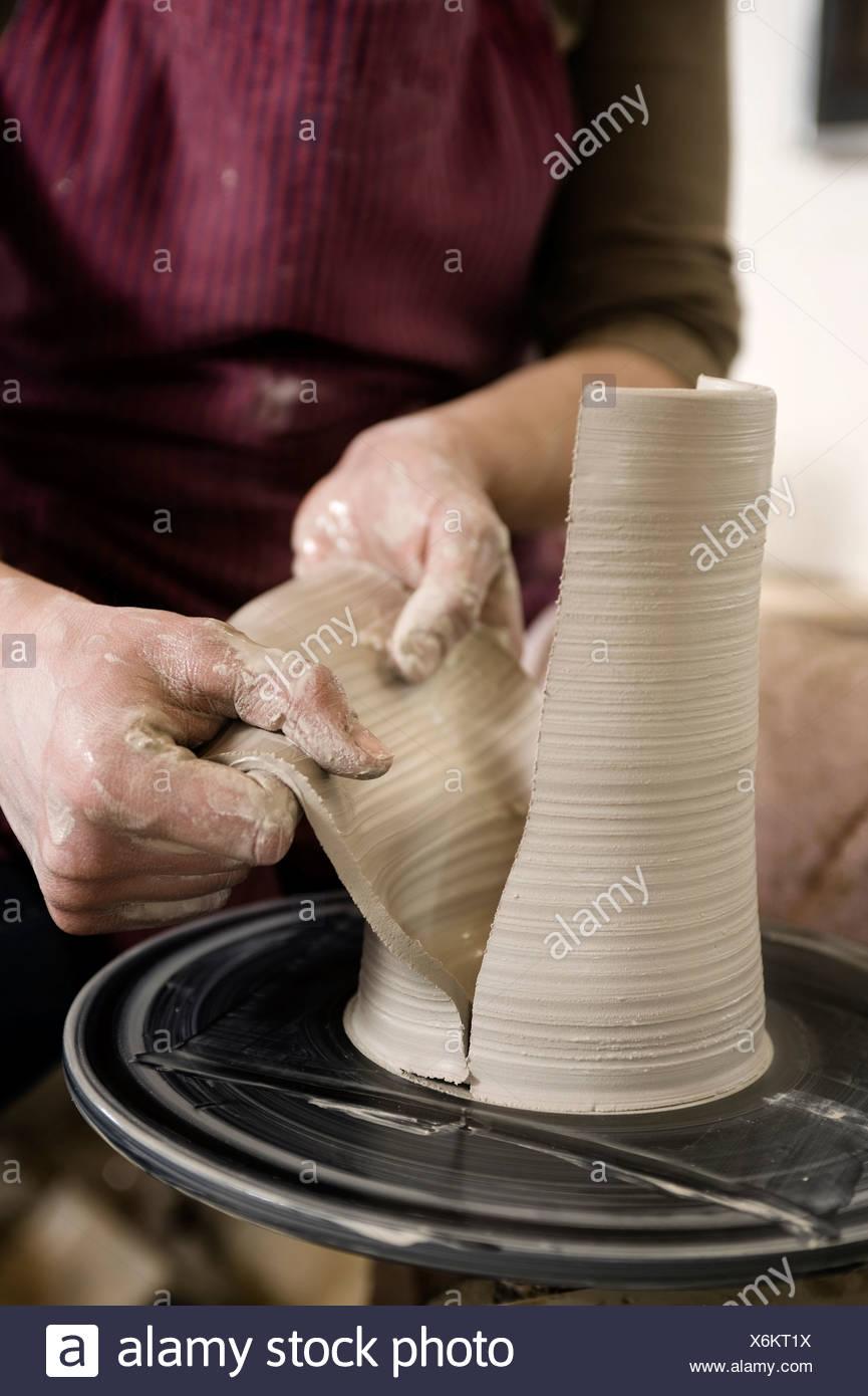 Craftswoman working on pottery wheel, Bavaria, Germany, Europe - Stock Image