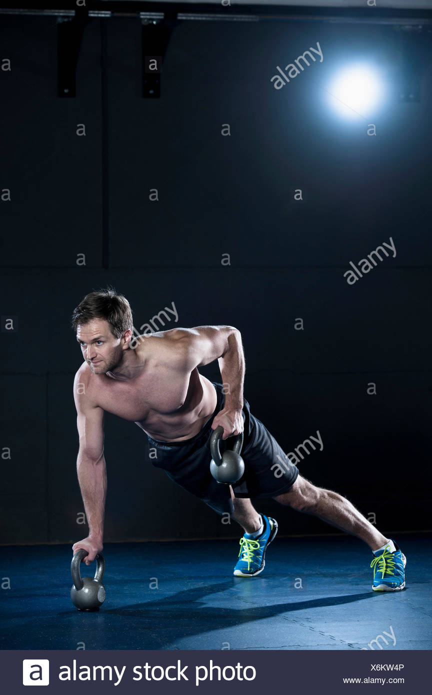 Athlete doing workout in fitness studio with Kettlebell, Bavaria, Germany - Stock Image
