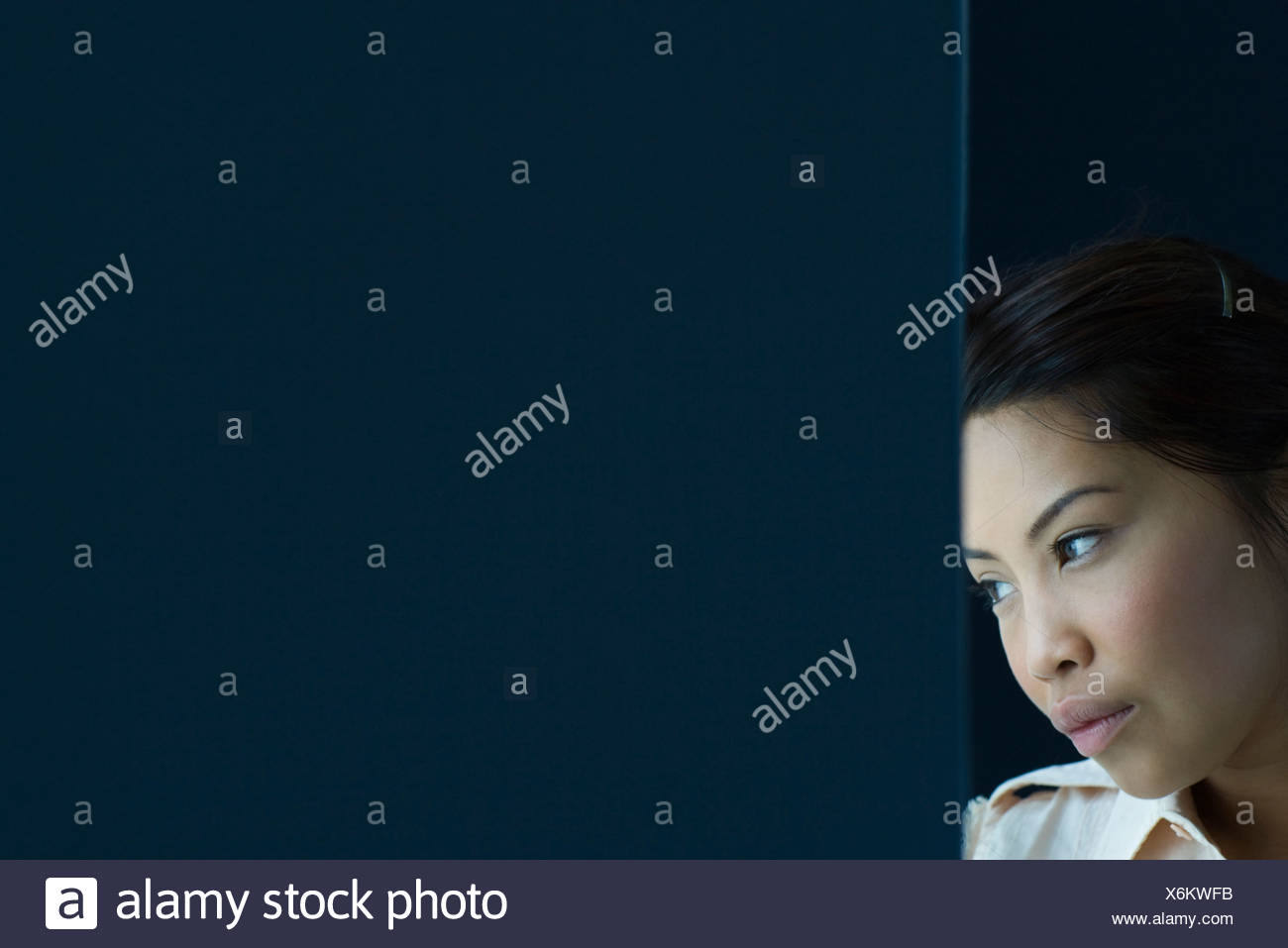 Woman daydreaming - Stock Image