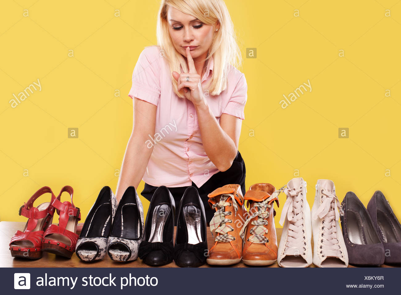 huge discount 419fb 7bb02 Blonde lady with a passion for shoes Stock Photo: 279492271 ...