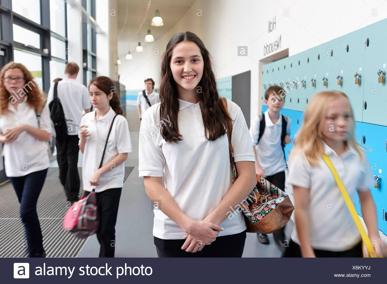 Schoolchildren in school corridor - Stock Image