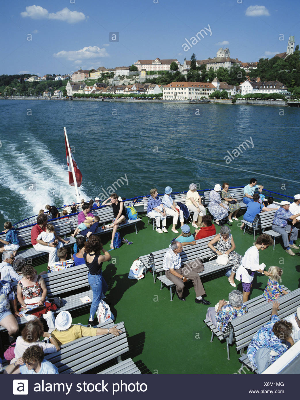 view lake Constance lake sea deck Germany Europe sea castle passengers foreground holiday boat ship - Stock Image