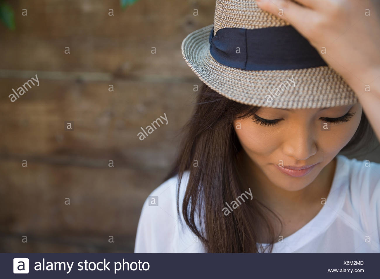 591f2dad5d263 Portrait serious woman in hat looking down - Stock Image