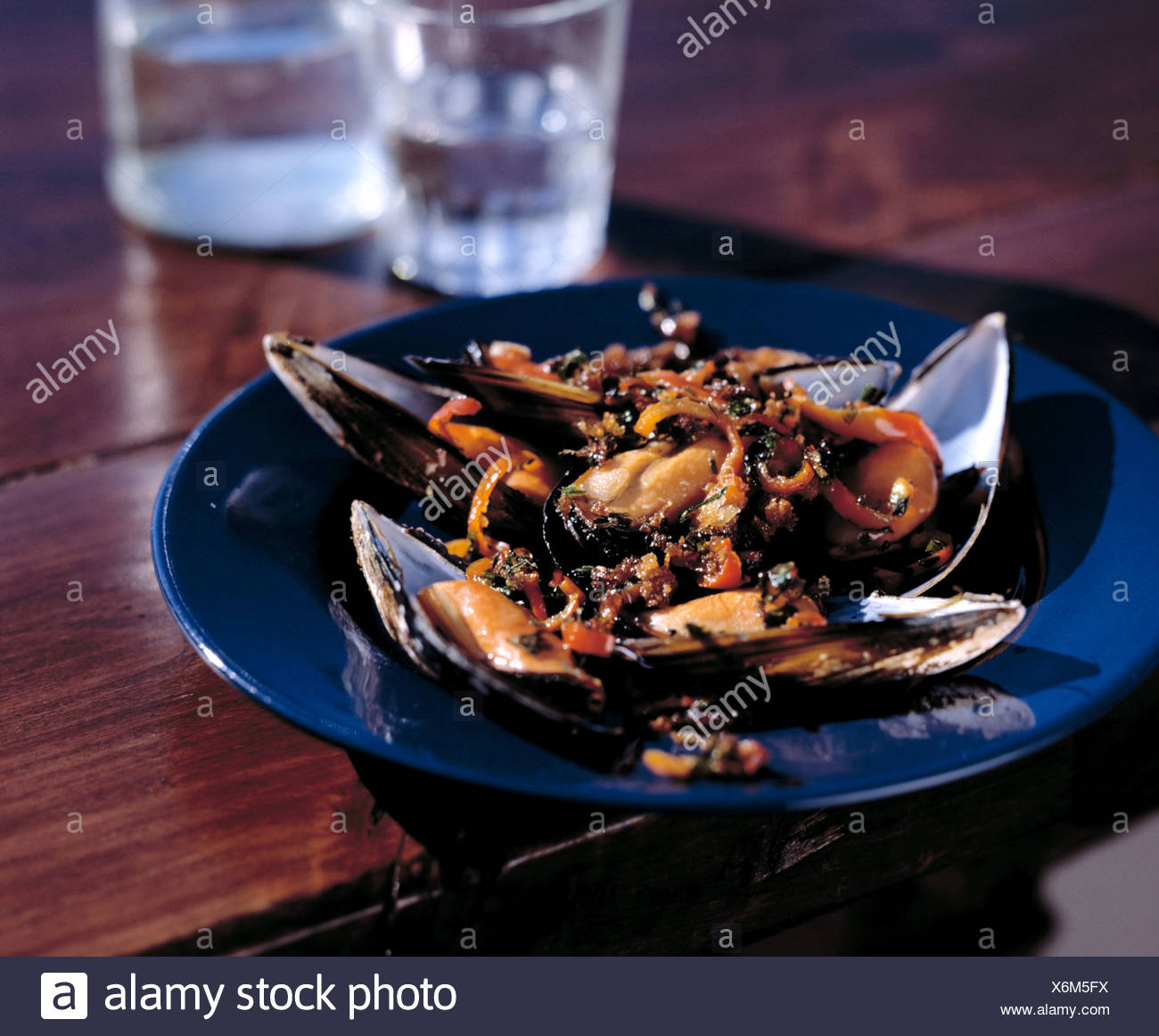 Blue mussels cooked au gratin - Stock Image