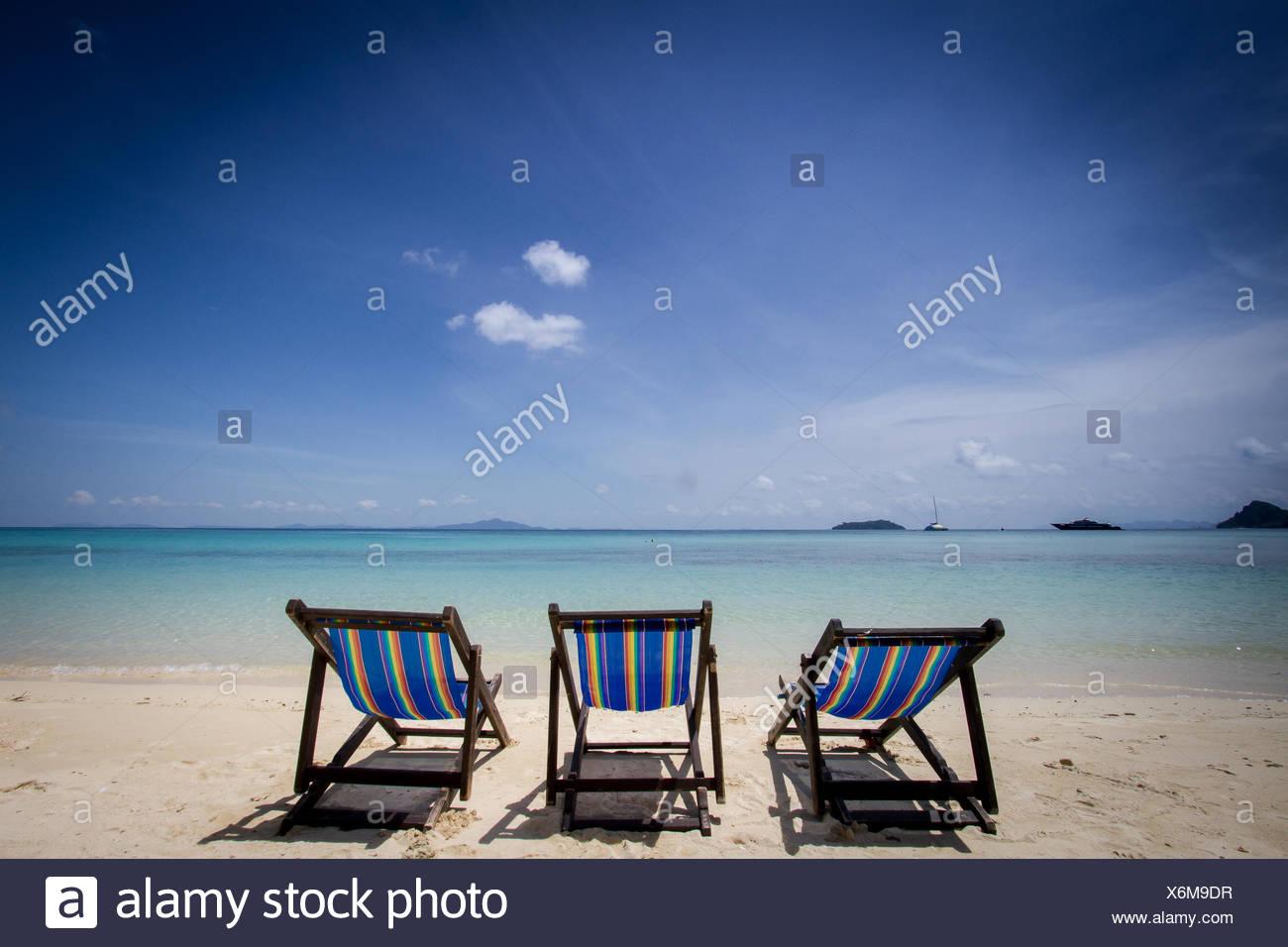 Thailand, Phuket, View of sun loungers on beach - Stock Image