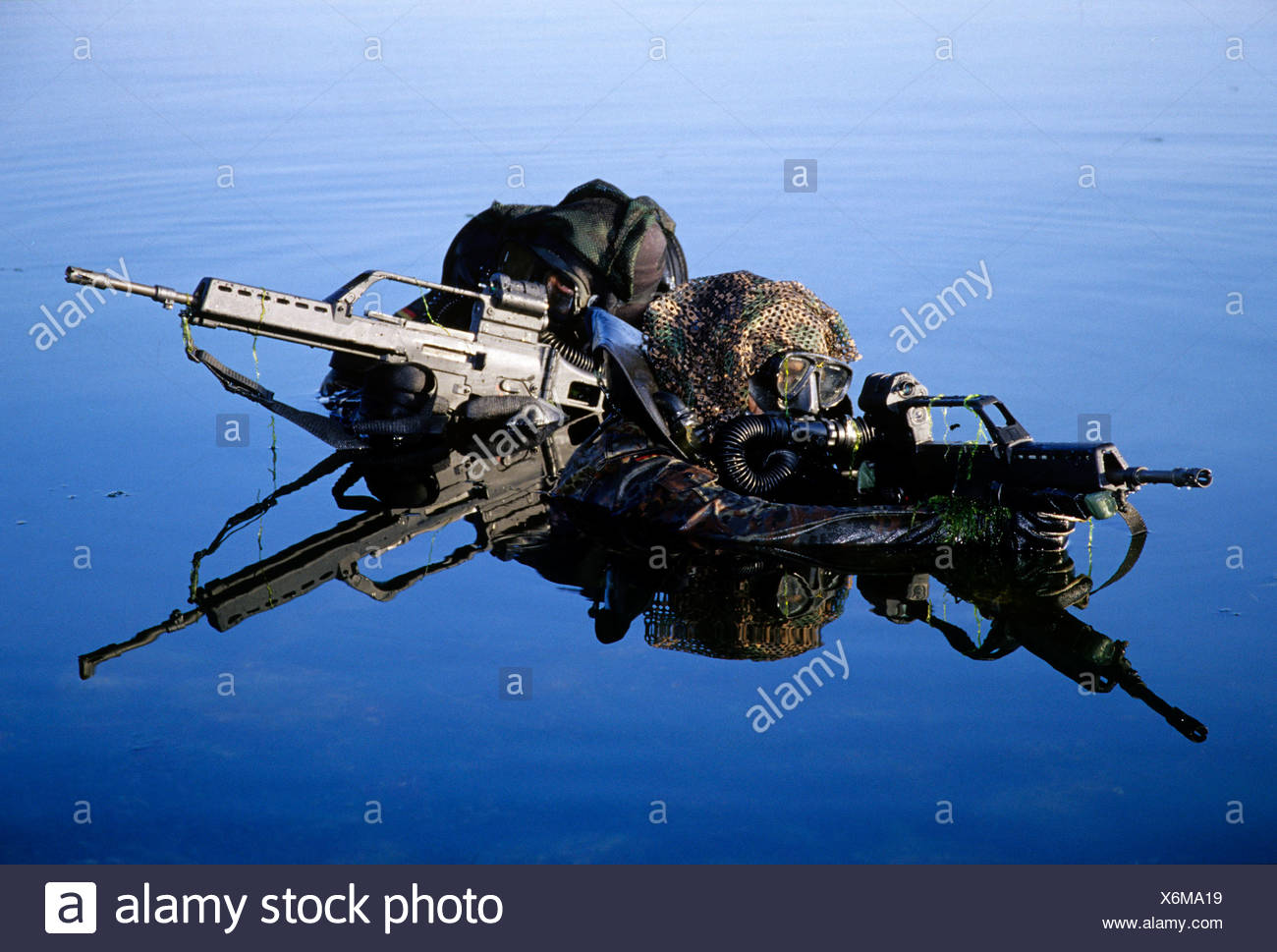 Two soldiers belonging to the Kampfschwimmerkompanie, combat swimmers, special unit of the German Navy practicing an attack on  - Stock Image