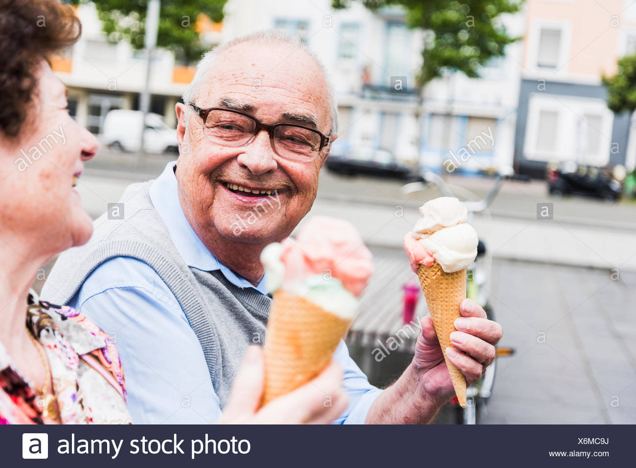 0cf148bb3c2b Portrait of happy senior man with ice cream cone looking at his wife -  Stock Image