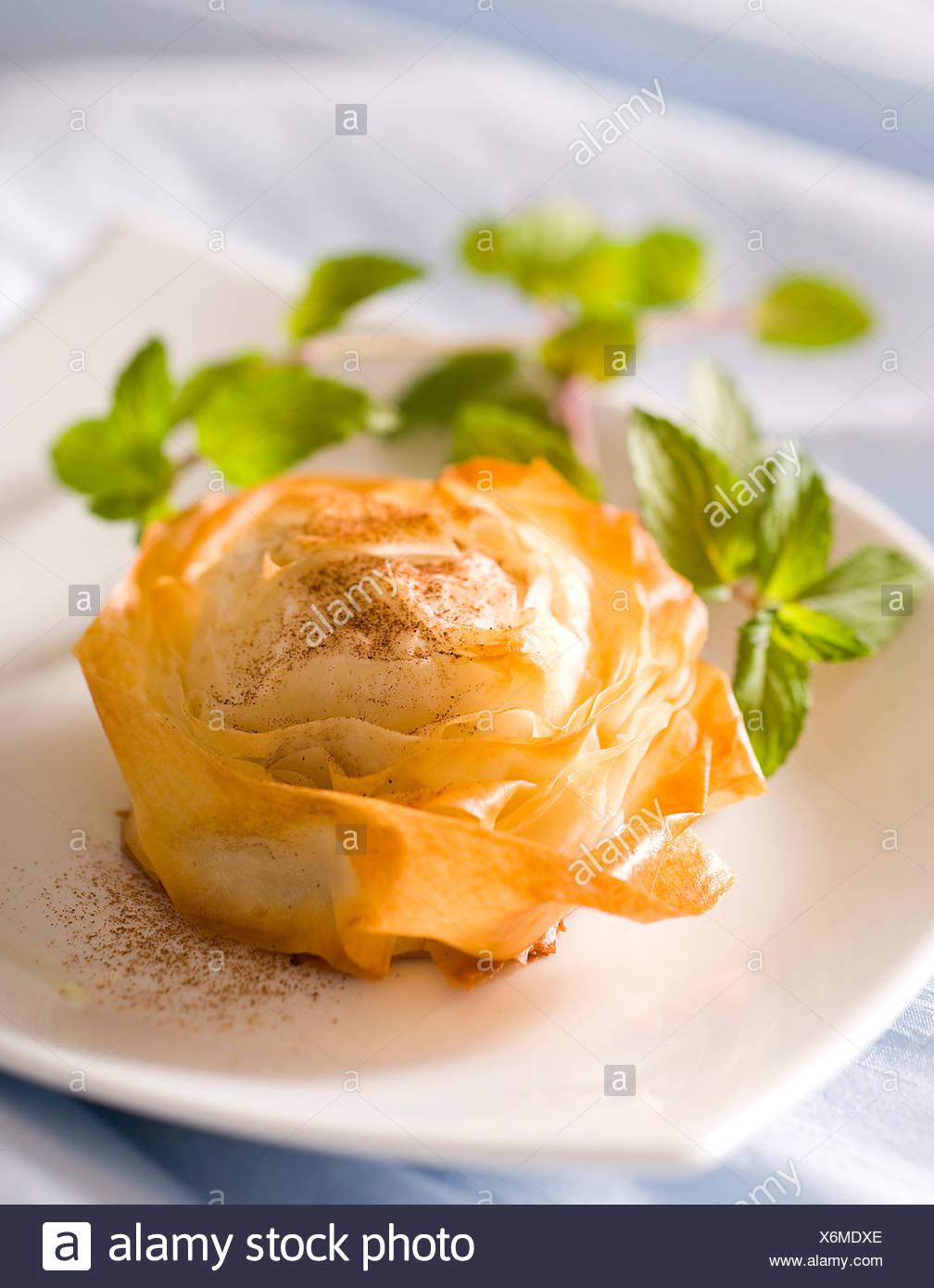 Apple Pie in Flower Corols - Stock Image