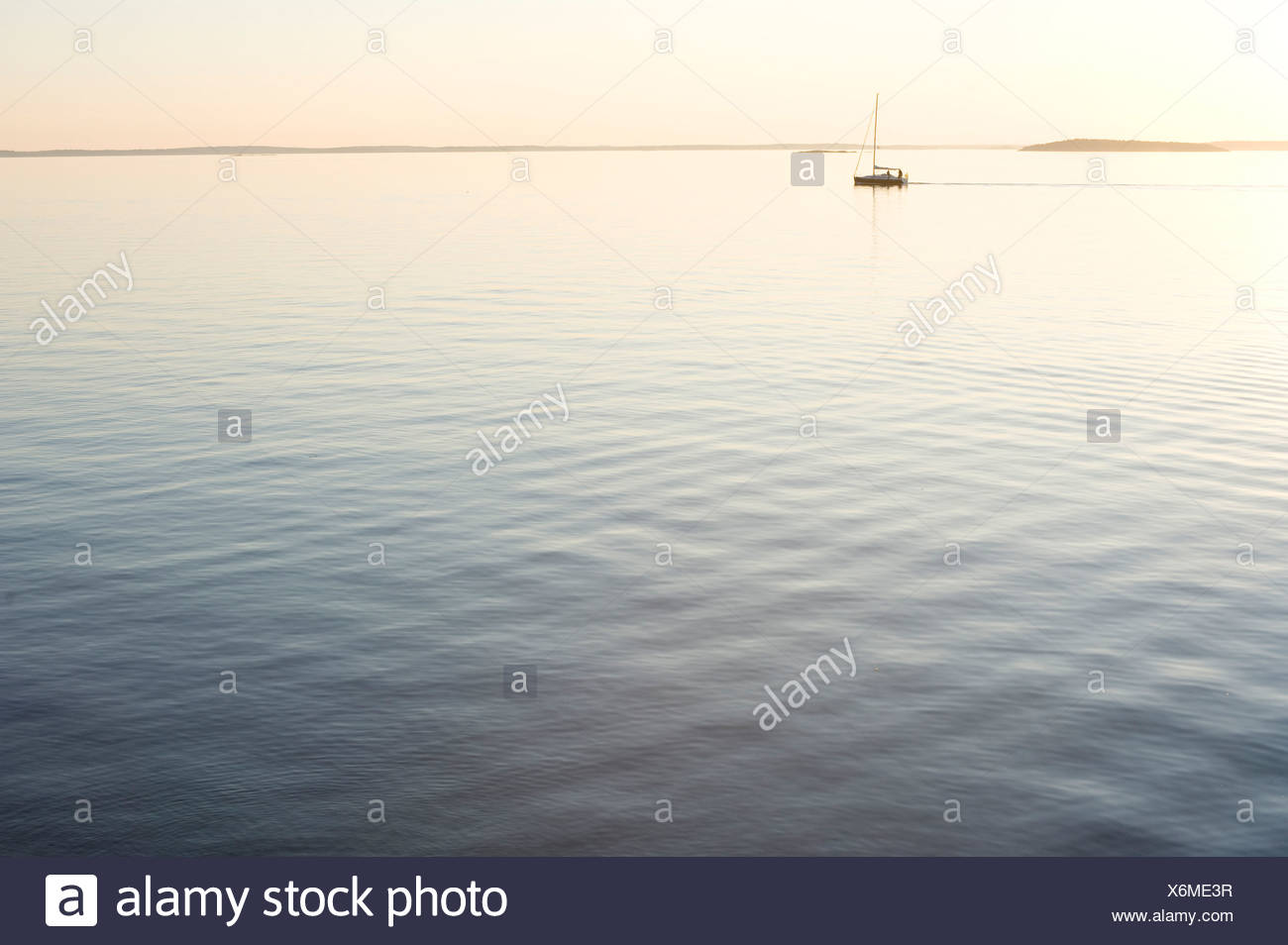 Lonely boat by the horizon - Stock Image