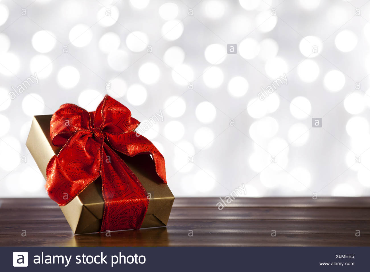Gift Box Wrapped With Red Bow - Stock Image