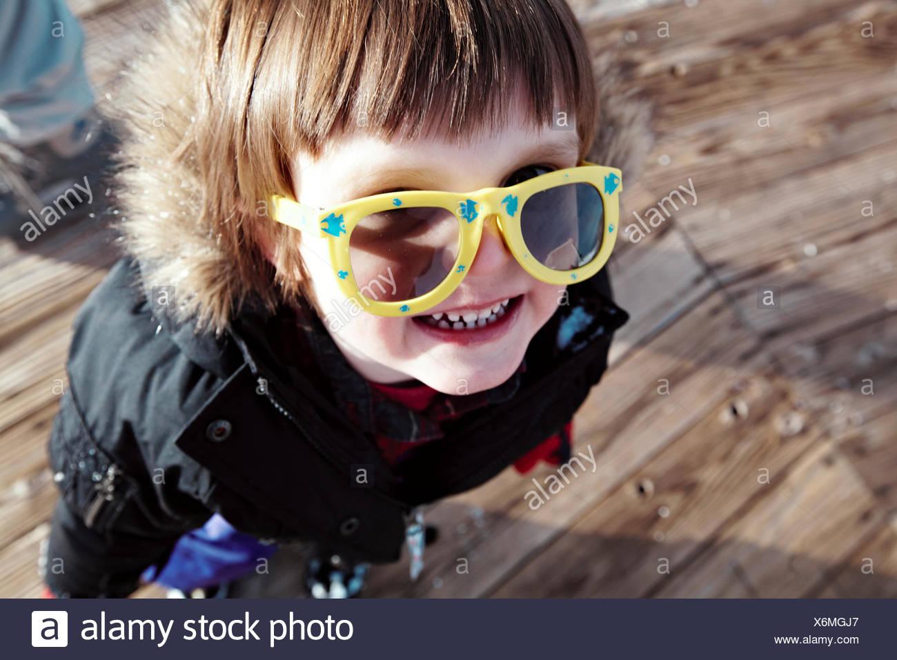 Baby boy (18-23 months) having fun at ski slope - Stock Image