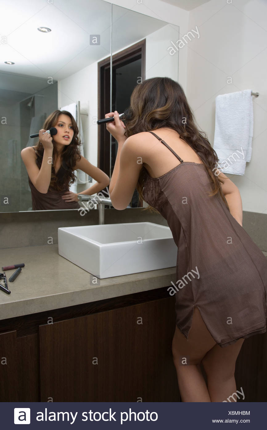 A woman applying make up - Stock Image
