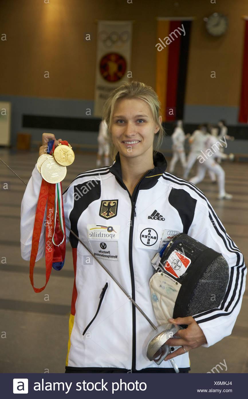 Epee fencer Britta Heidemann, TSV Bayer 04 Leverkusen, showing her gold medals, Bonn, North Rhine-Westphalia, Germany, Europe - Stock Image