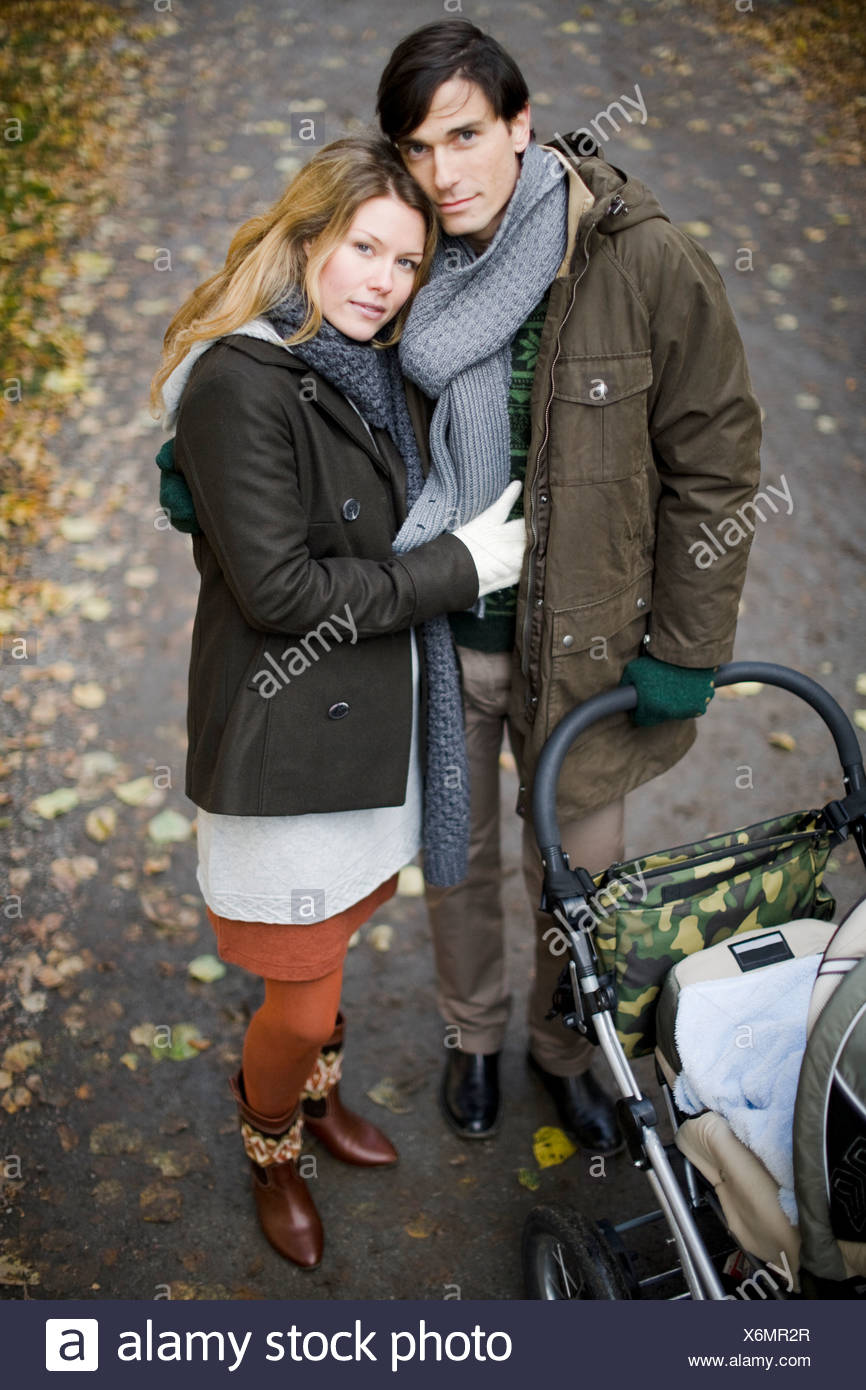 A couple taking a walk with their baby - Stock Image