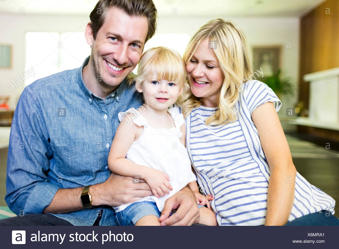 Family portrait with daughter (2-3) - Stock Image