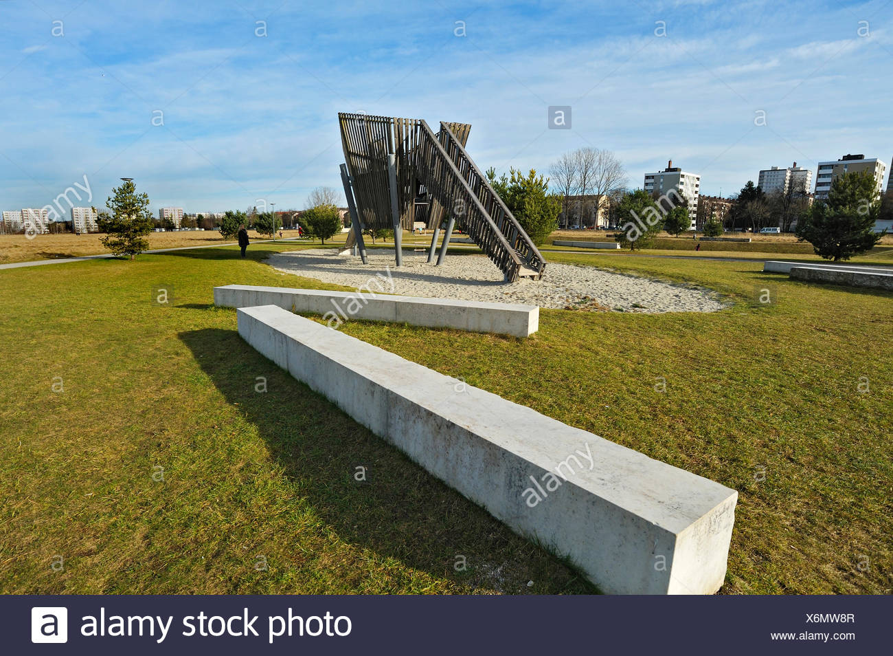 Concrete benches and a slide on a playground - Stock Image