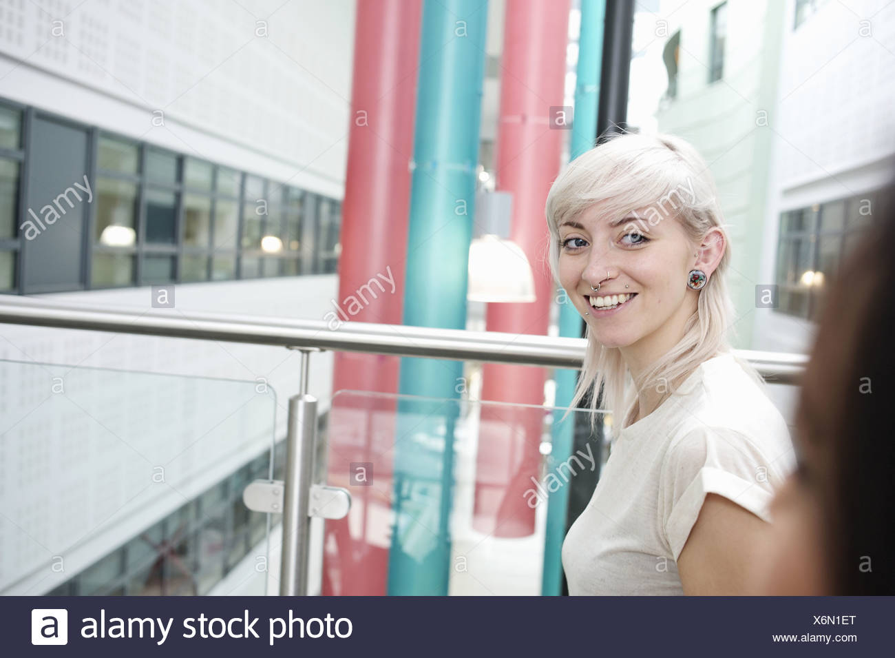 Young woman with blonde hair smiling, portrait Stock Photo