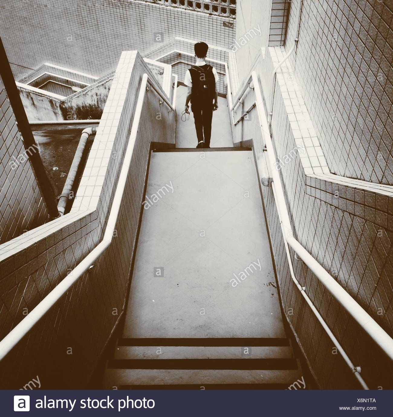 how to walk down stairs with a cane