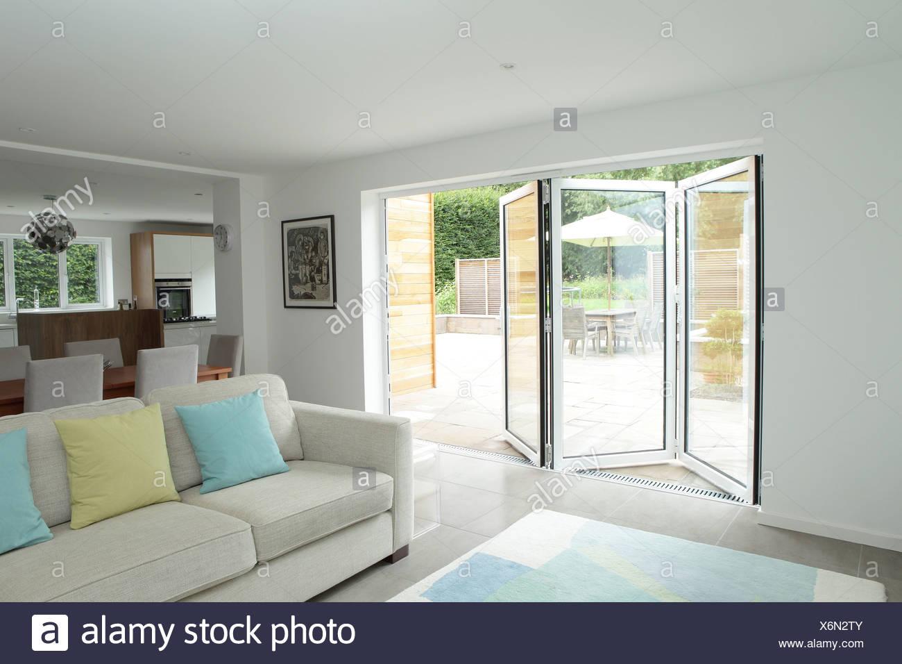 Open plan living area with open patio doors Stock Photo: 279517083 ...