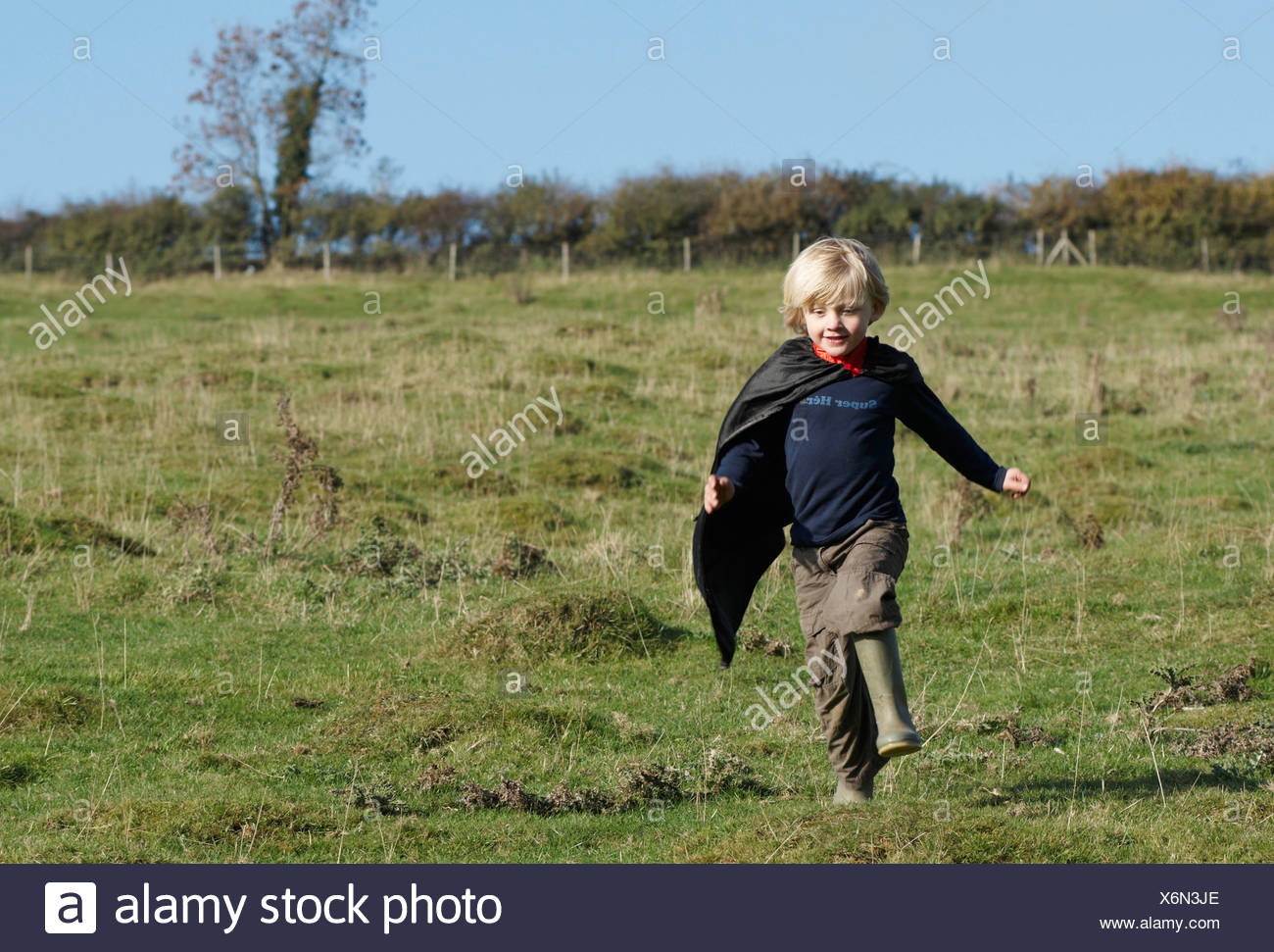 Super Hero boy in countryside - Stock Image