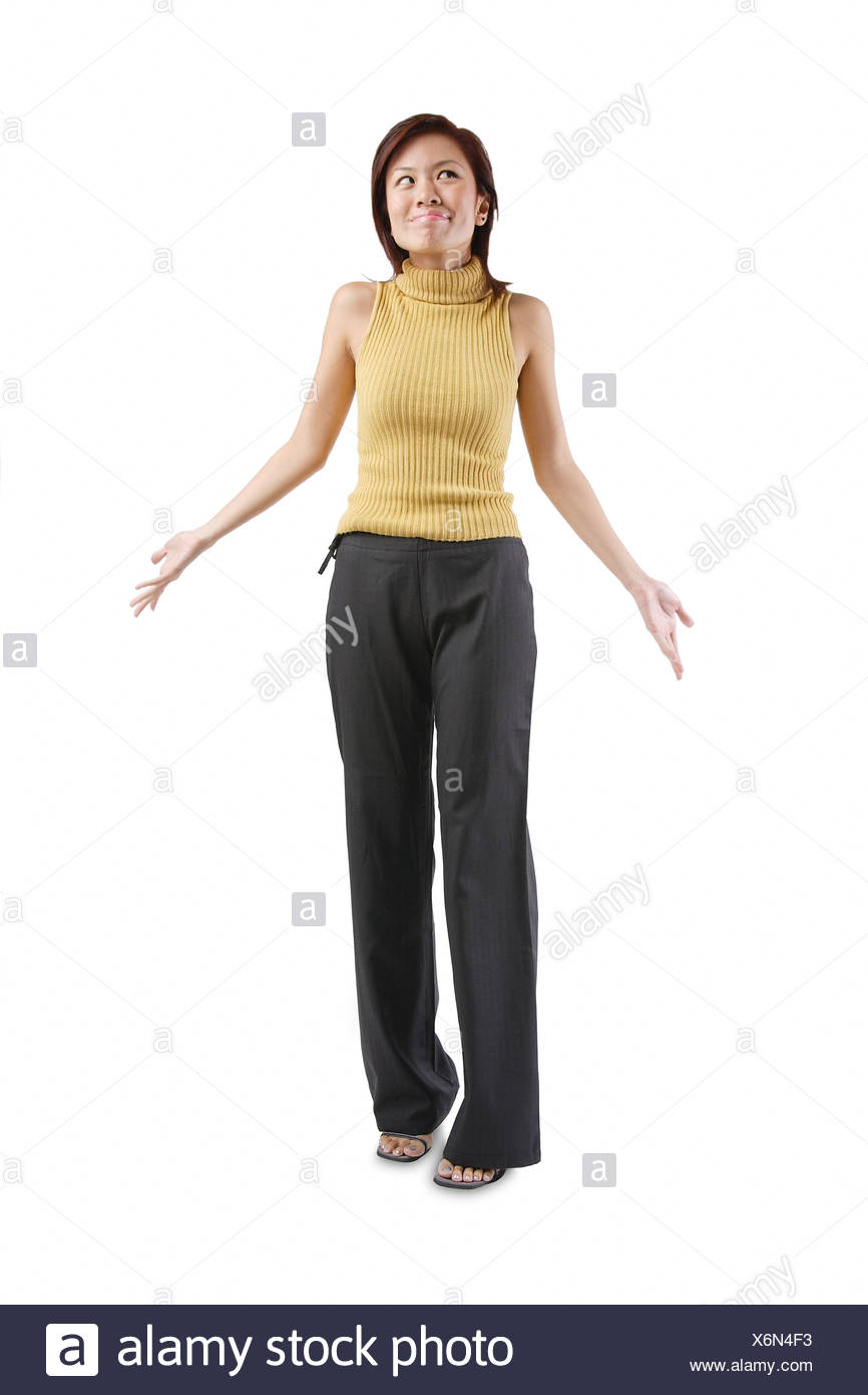 Young woman standing hands at her side palms up