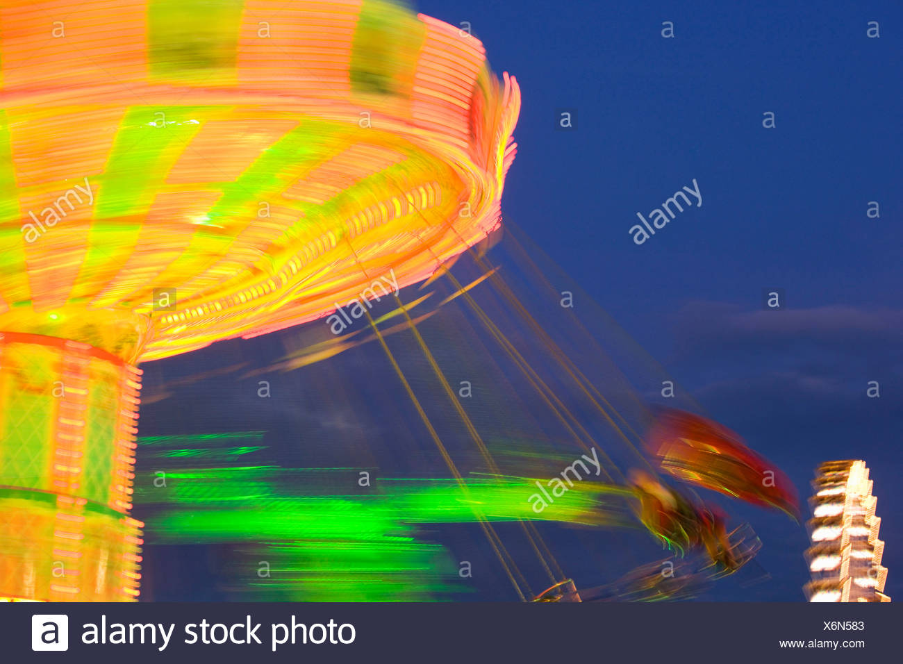 Rotating carrousel by night - Stock Image