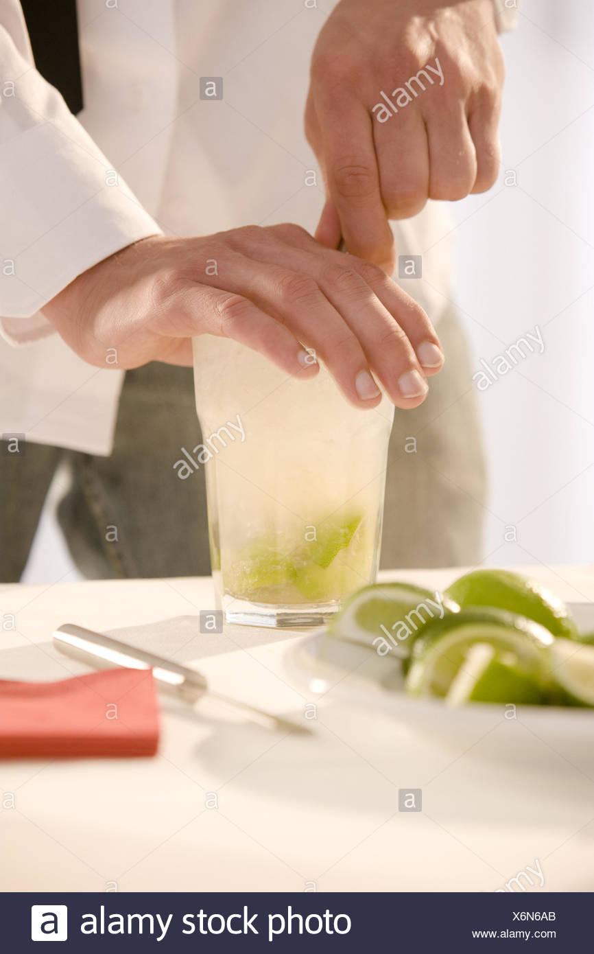 Barkeepers, detail, hands, cocktail, Caipirinha, prepare, stir, Stock Photo