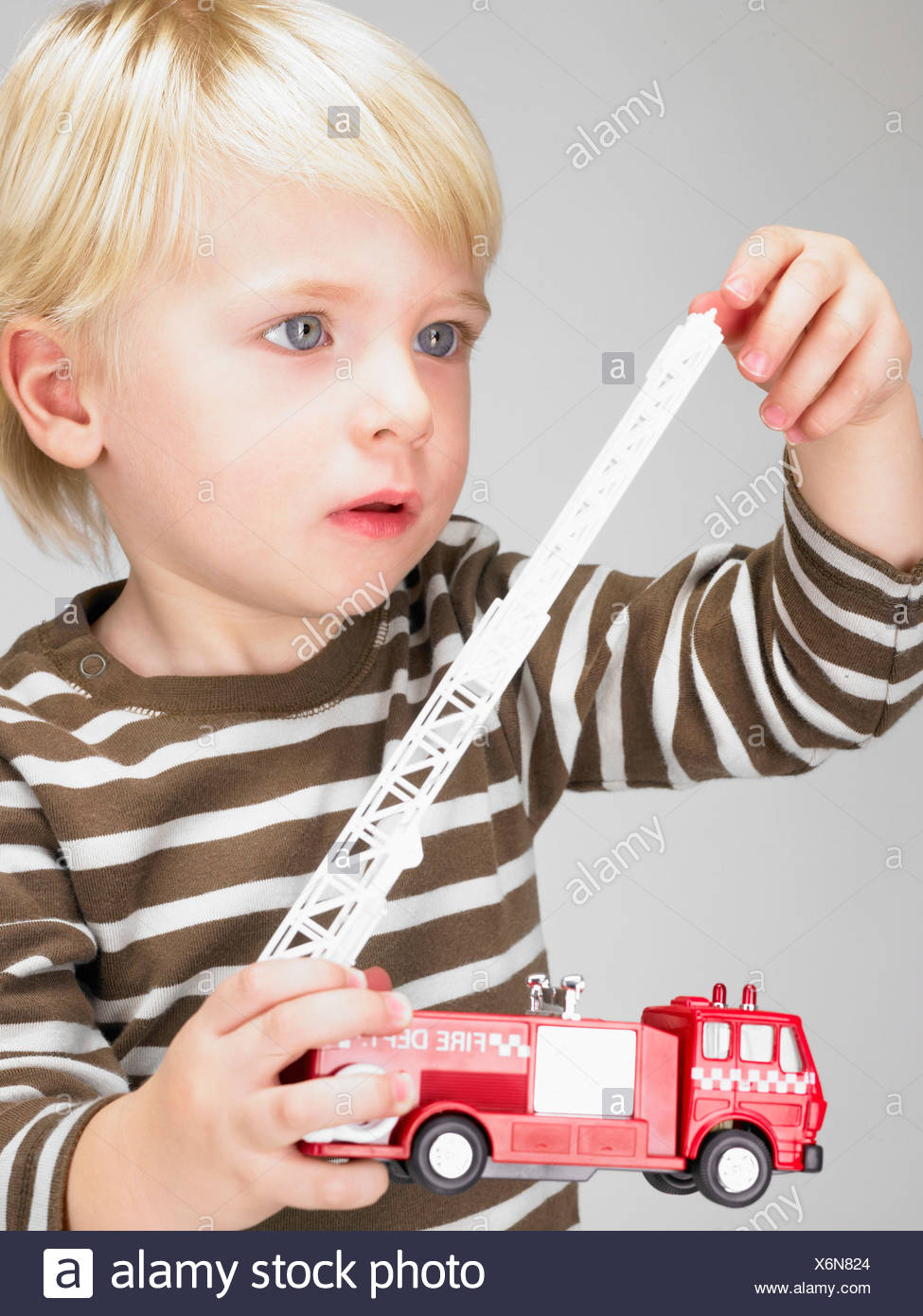 Little Boy Playing With Fire Truck Stock Photo 279521148