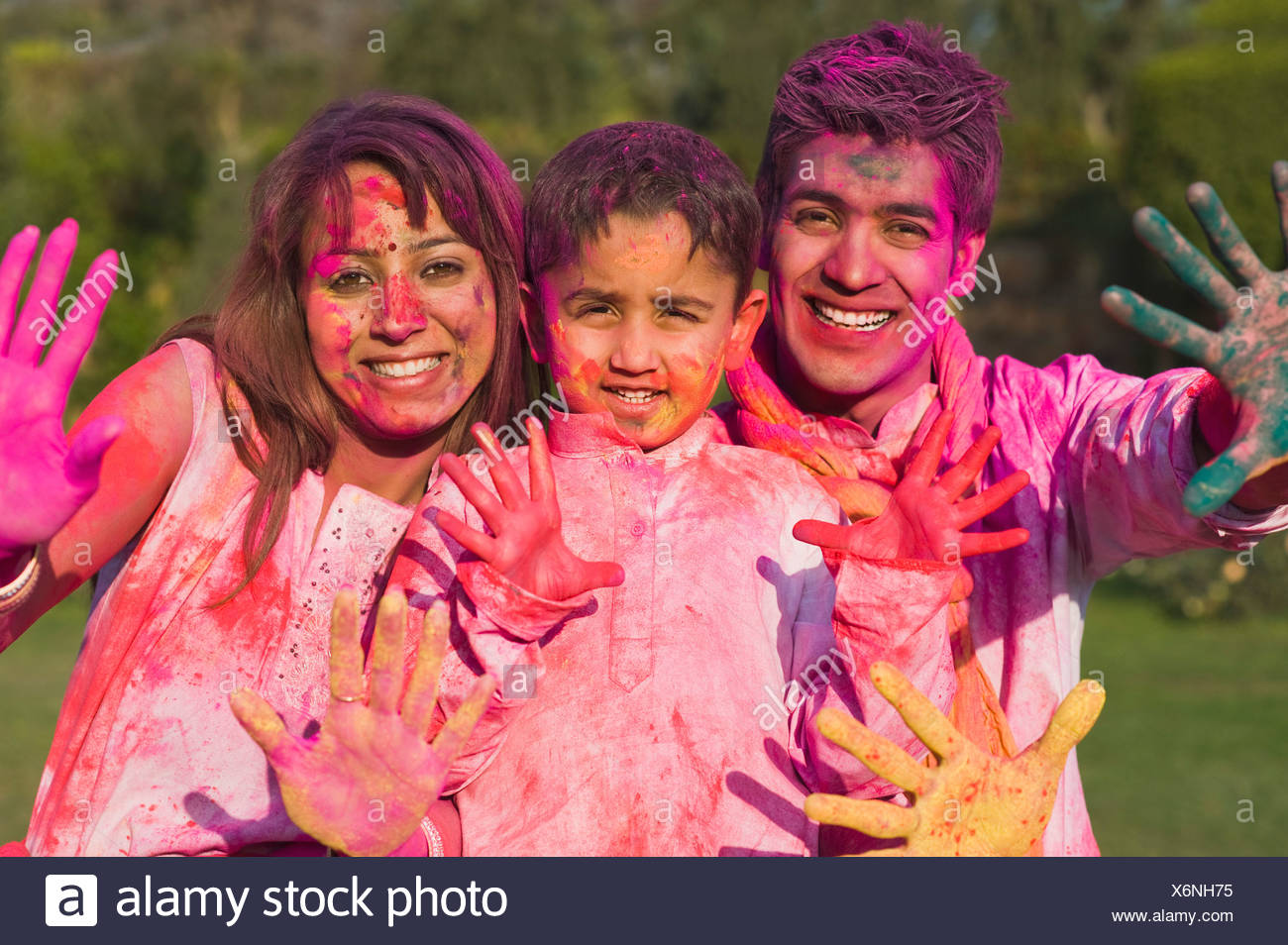 Family showing colorful hands on Holi Stock Photo: 279528345 - Alamy