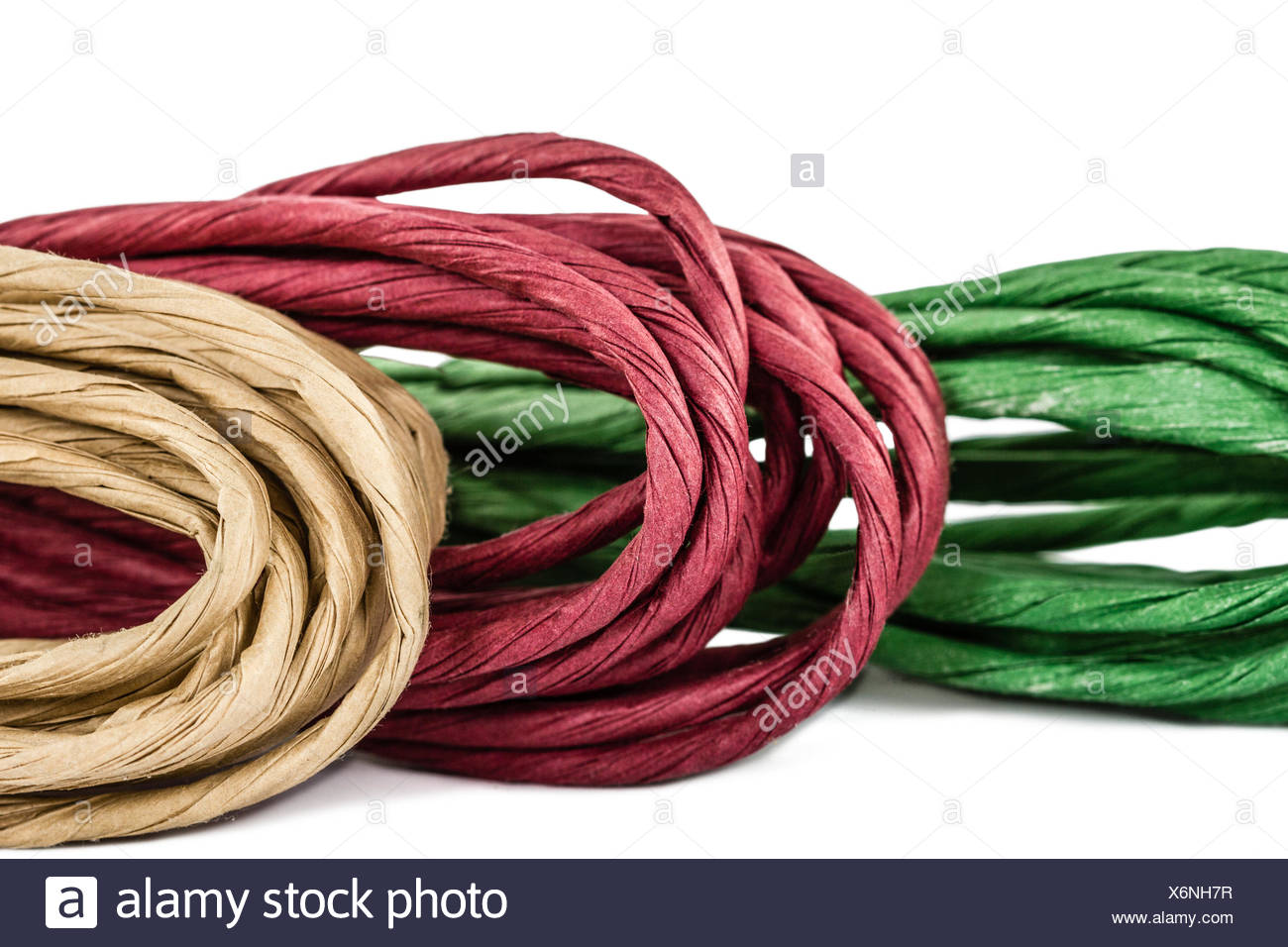 Rope in skeins, isolated on white background - Stock Image