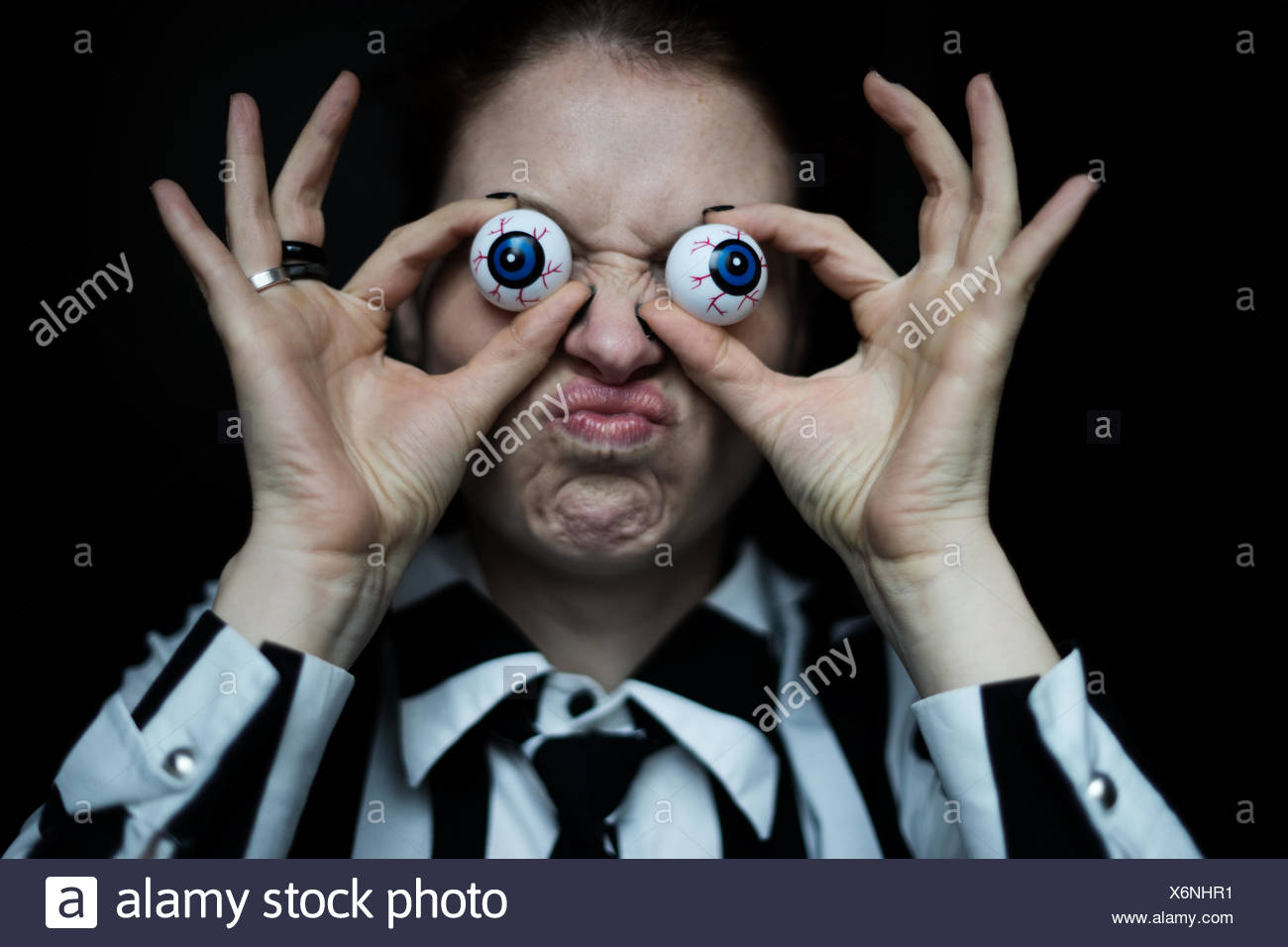 Woman grimacing, artificial eyes Stock Photo