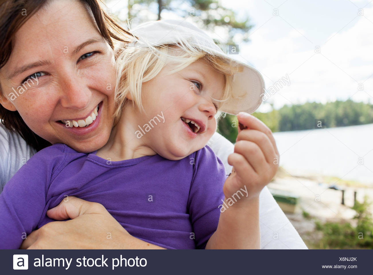 Sweden, Vastergotland, Vattlefjall nature reserve, Mother holding daughter (2-3) - Stock Image