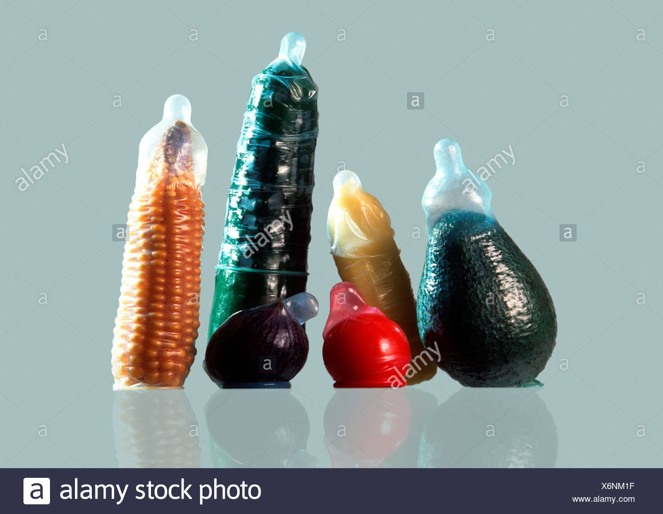 pest management, vegetables encased with condoms. - Stock Image