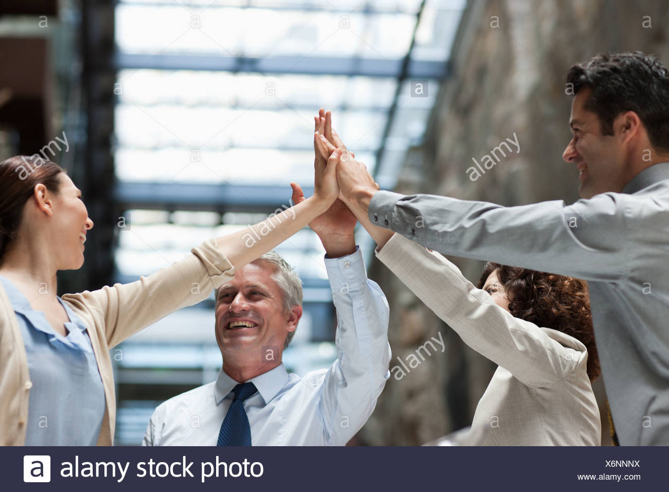 Business people with hands together - Stock Image