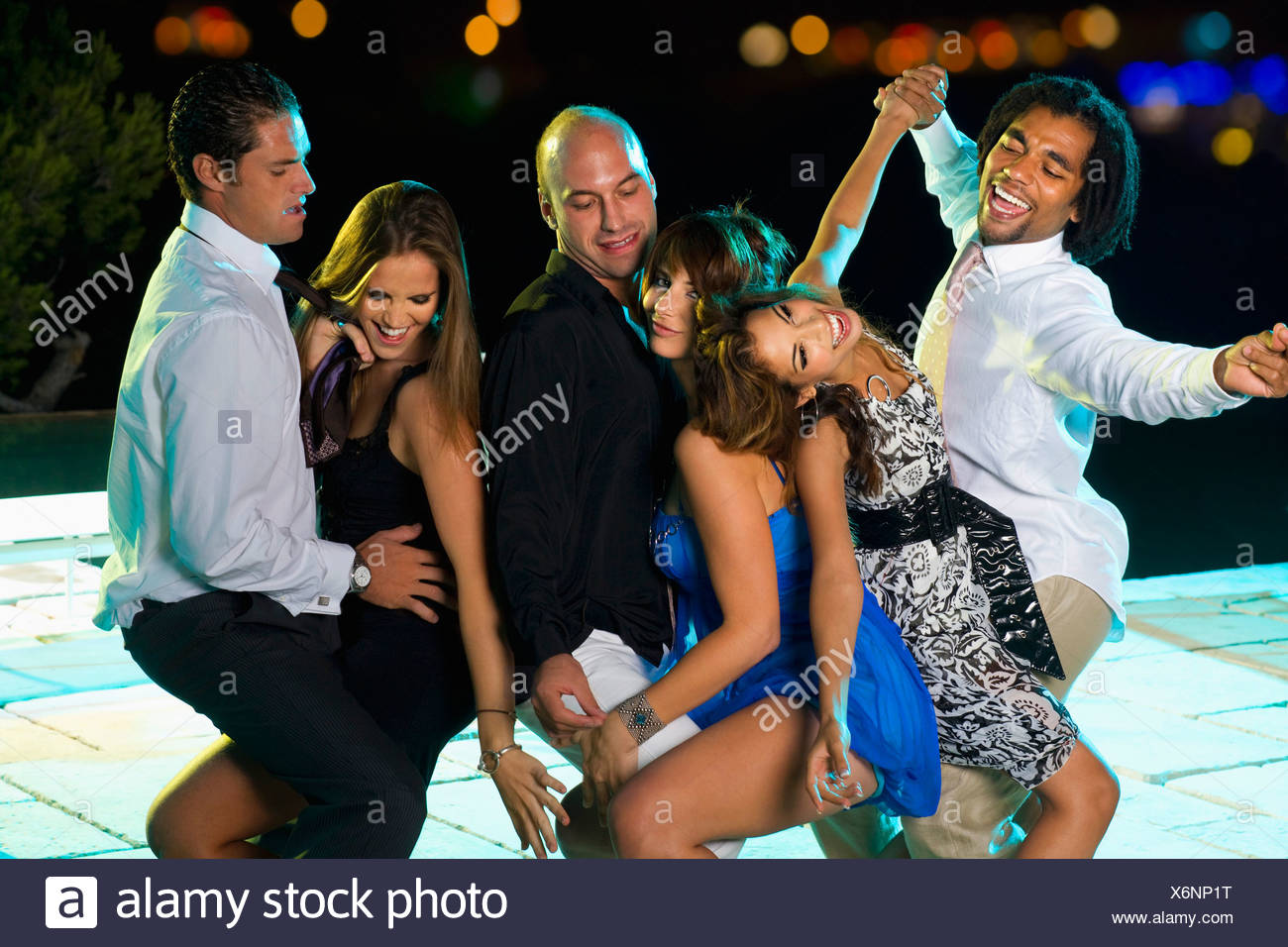 Men and women at a party - Stock Image