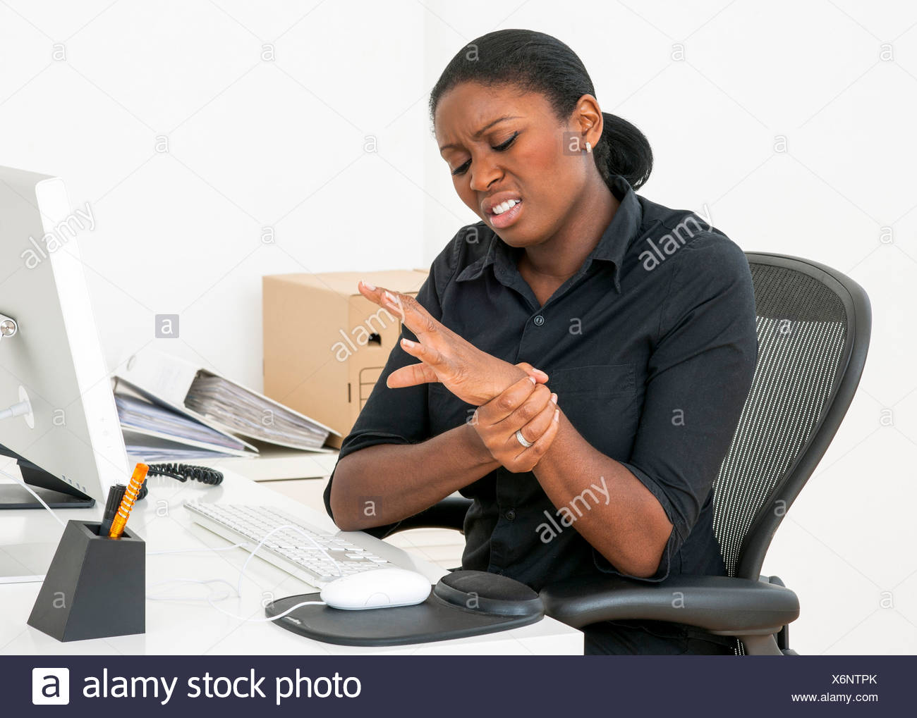 MODEL RELEASED Repetitive strain injury RSI - Stock Image