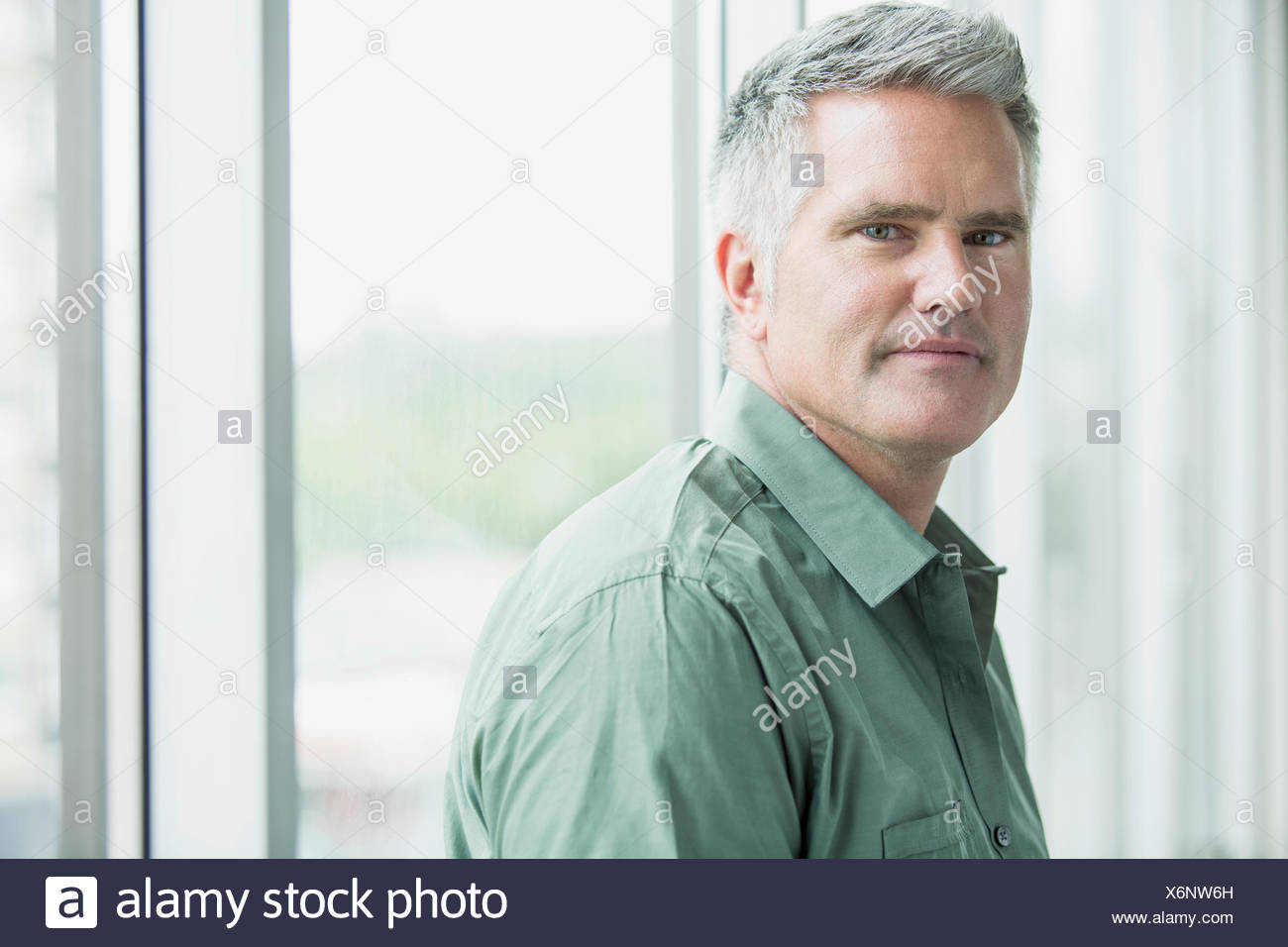 portrait of middle aged businessman with serious look - Stock Image