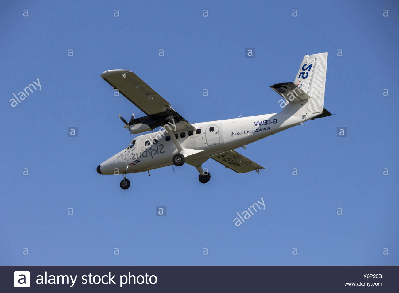 Isle of Scilly Skybus De Havilland Canada DHC-6 Twin Otter Series 310. This is the plane that bird watching visitors to The Scilly Island use. - Stock Image