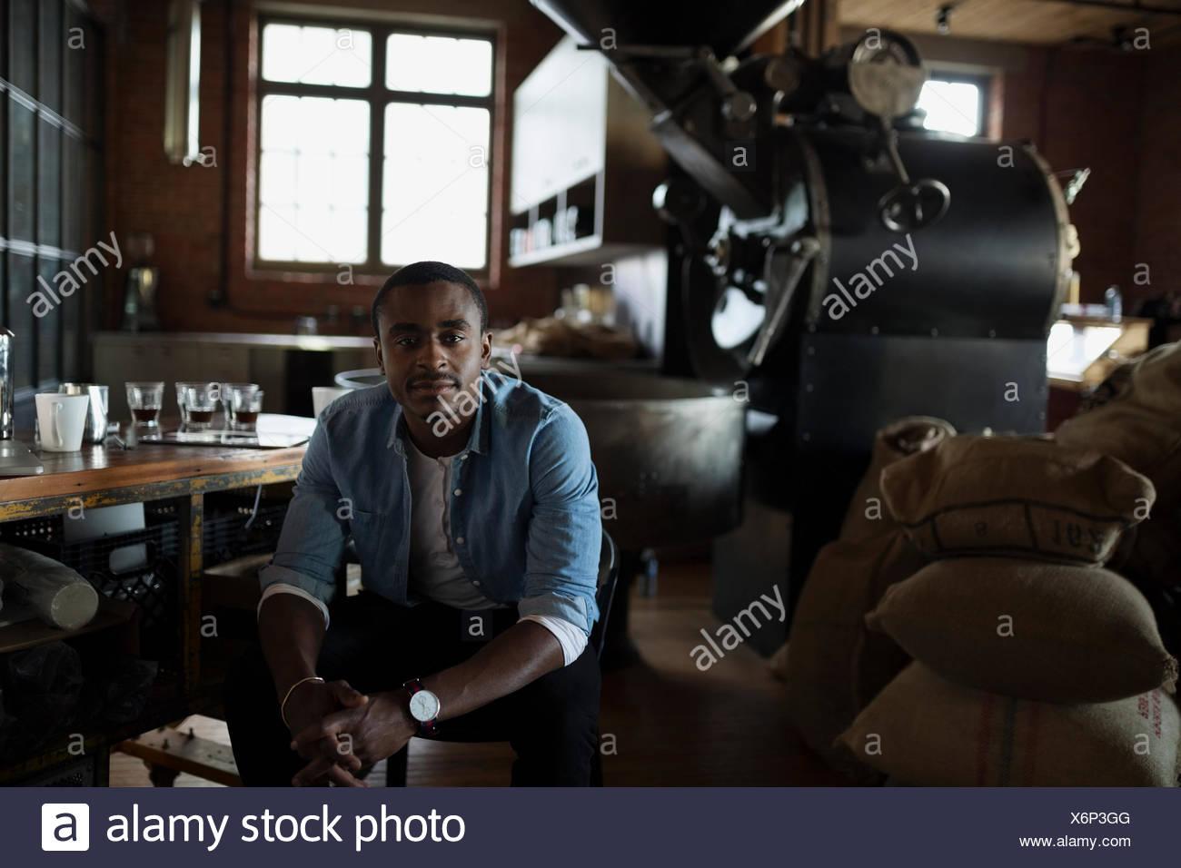 Portrait confident entrepreneurial coffee roaster - Stock Image