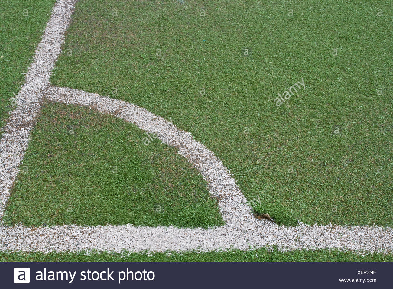 Corner of football field with fake grass - Stock Image