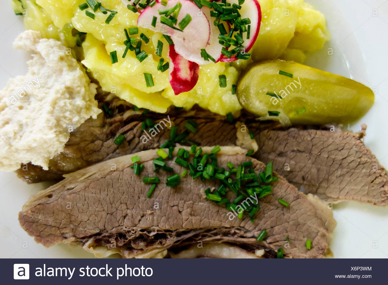 Prime boiled beef with horseradish and potato salad - Stock Image