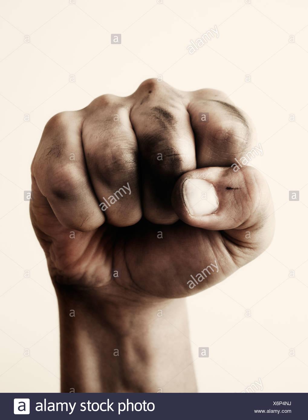 Close-up of fist, studio shot - Stock Image