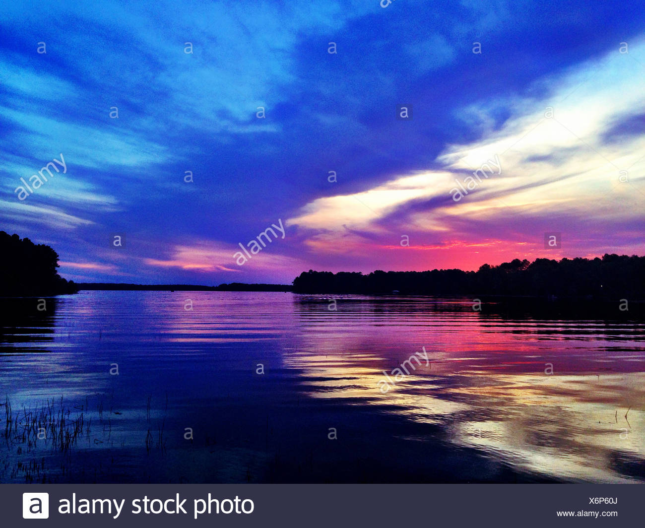 USA, Cloudy sunset on Toledo Bend - Stock Image