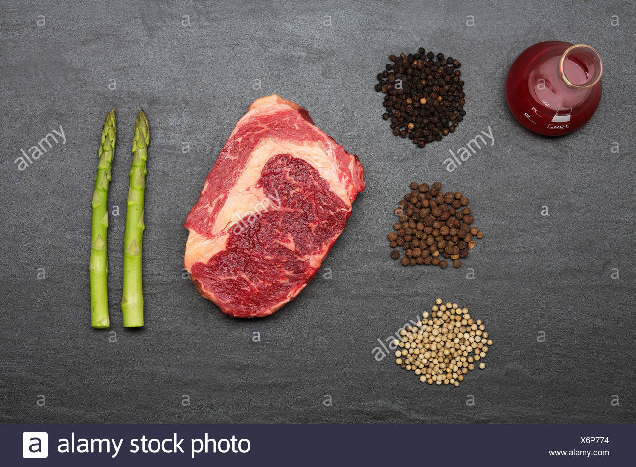 Meat, spices and vegetables on counter Stock Photo
