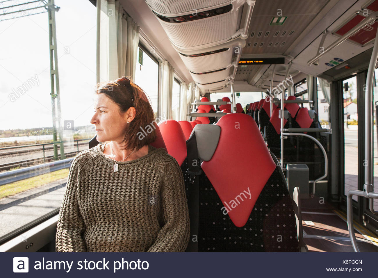 Woman sitting on a train - Stock Image