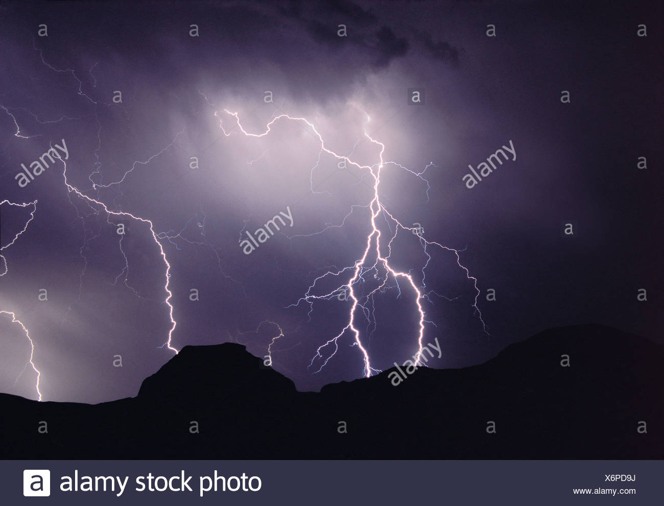 Lightning storm at night over Castle Butte, Big Muddy Badlands, Saskatchewan, Canada - Stock Image