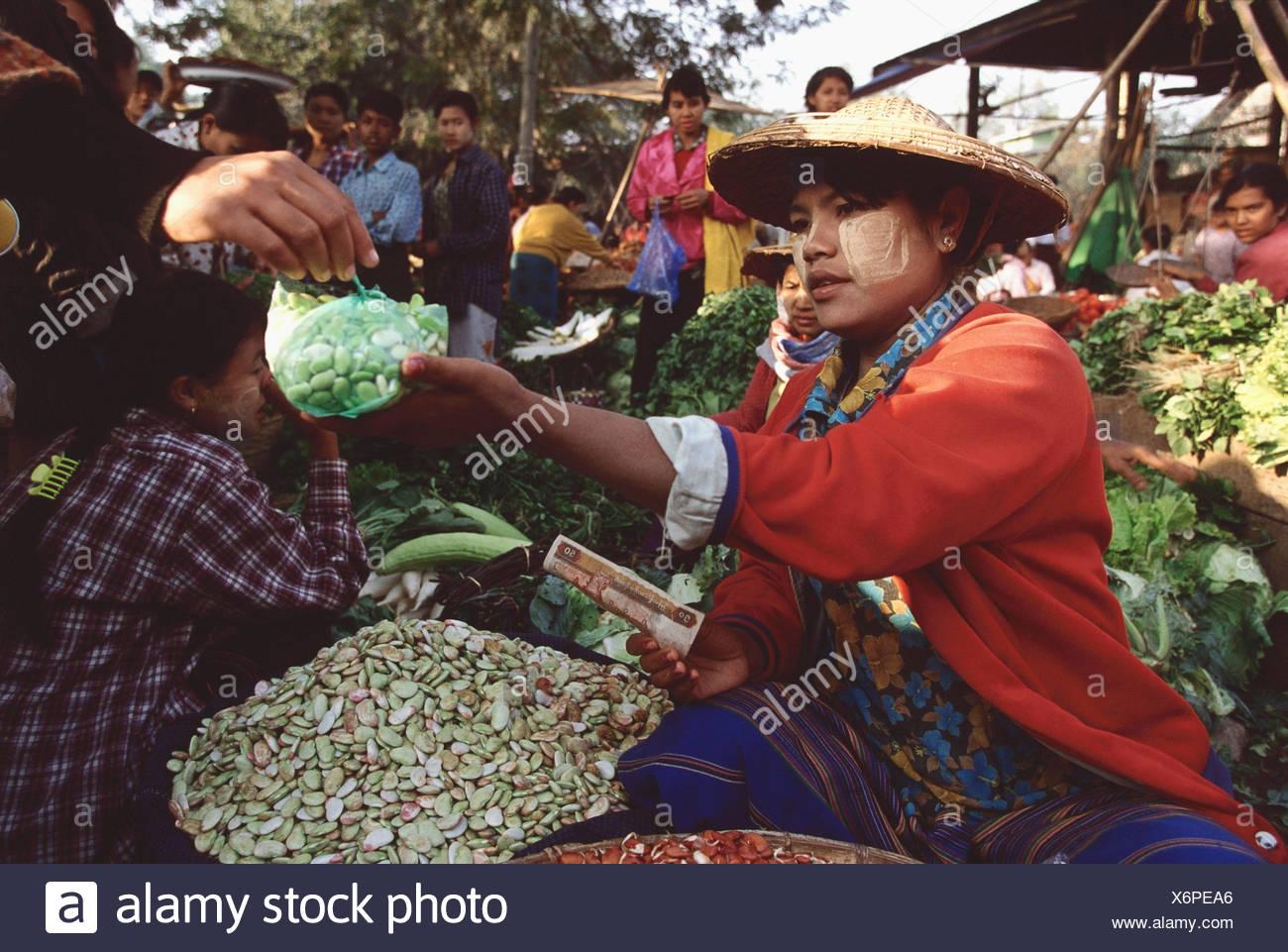 Myanmar (Burma), Sangaing, Woman selling beans at morning