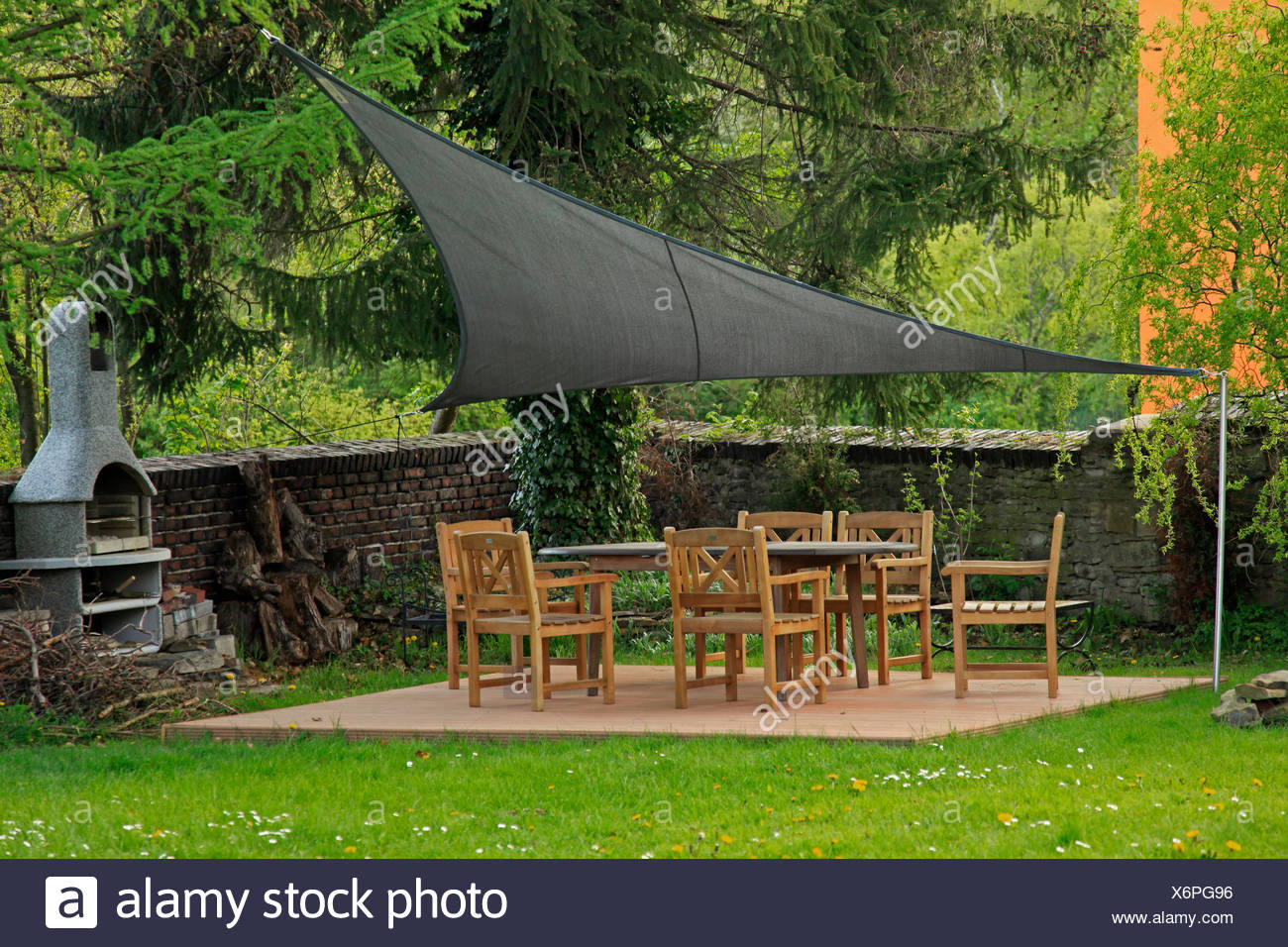 stretched awning over garden furnitures, Germany - Stock Image